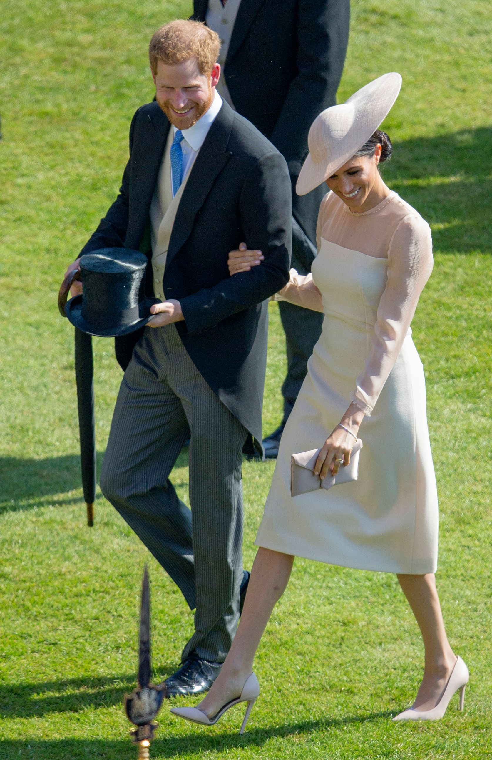 <div class='meta'><div class='origin-logo' data-origin='none'></div><span class='caption-text' data-credit='IAN VOGLER/AFP/Getty Images'>Prince Harry, Duke of Sussex and his new wife Britain's Meghan, Duchess of Sussex, attend the Prince of Wales's 70th Birthday Garden Party at Buckingham Palace in London on May 22.</span></div>