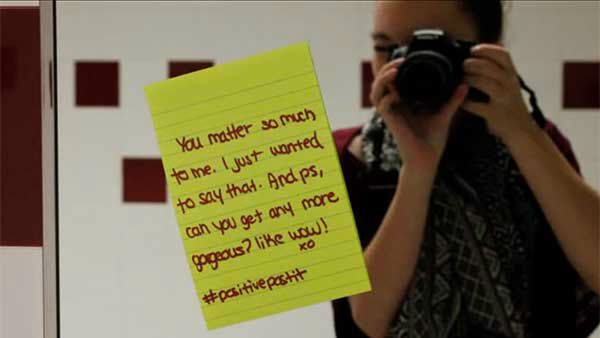 "<div class=""meta image-caption""><div class=""origin-logo origin-image ""><span></span></div><span class=""caption-text"">The ''Positive Post-It Day'' started as a campaign to spread positivity in Caitlin Prater Haacke's school, but it soon spread to homes, places of work and beyond. (Photo/YouTube, Caitlin Prater-Haacke)</span></div>"