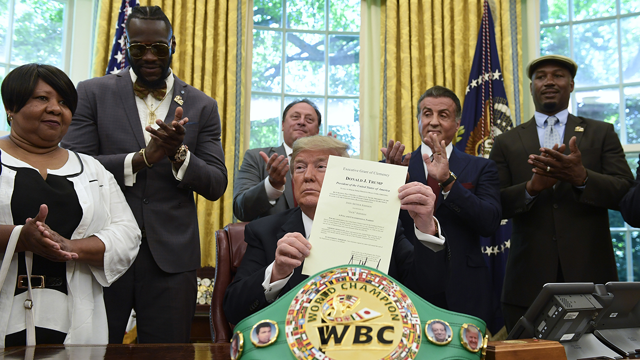 President Trump pardons Jack Johnson. From left, Johnson's great-great niece Linda Haywood, boxer Deontay Wilder, Keith Frankel, Sylvester Stallone, and former champ Lennox Lewis.