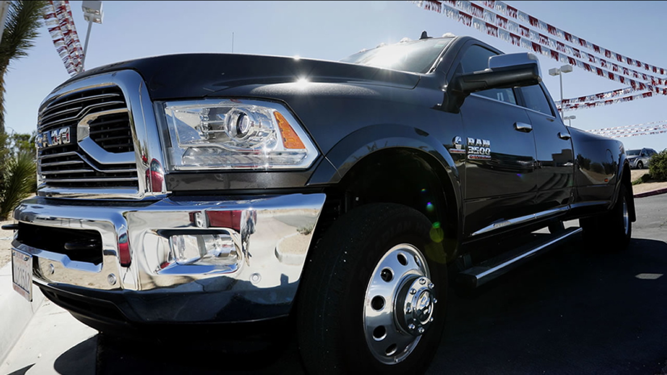 A Ram 3500 pickup truck sits on a dealership in Yucca Valley, Calif. on May 12, 2017. Fiat Chrysler makes Ram trucks among other cars.