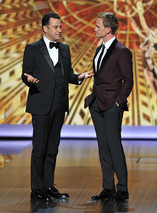 "<div class=""meta image-caption""><div class=""origin-logo origin-image ""><span></span></div><span class=""caption-text"">Jimmy Kimmel and host Neil Patrick Harris speaks on stage at the 65th Primetime Emmy Awards at Nokia Theatre on Sunday Sept. 22, 2013, in Los Angeles. (Vince Bucci/Invision/AP)</span></div>"