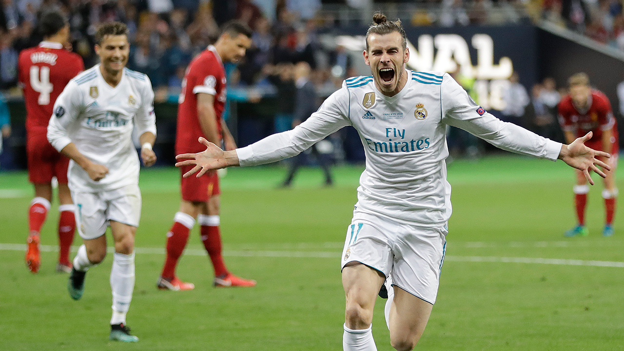 Real Madrid's Gareth Bale celebrates after scoring his side's second goal during the Champions League Final soccer match between Real Madrid and Liverpool at Olimpiyskiy Stadium.