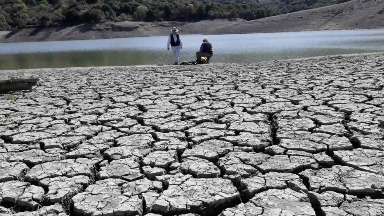 The dry bed of the Stevens Creek Reservoir is seen on Thursday, March 13, 2014, in Cupertino, Calif. (AP Photo/Marcio Jose Sanchez)