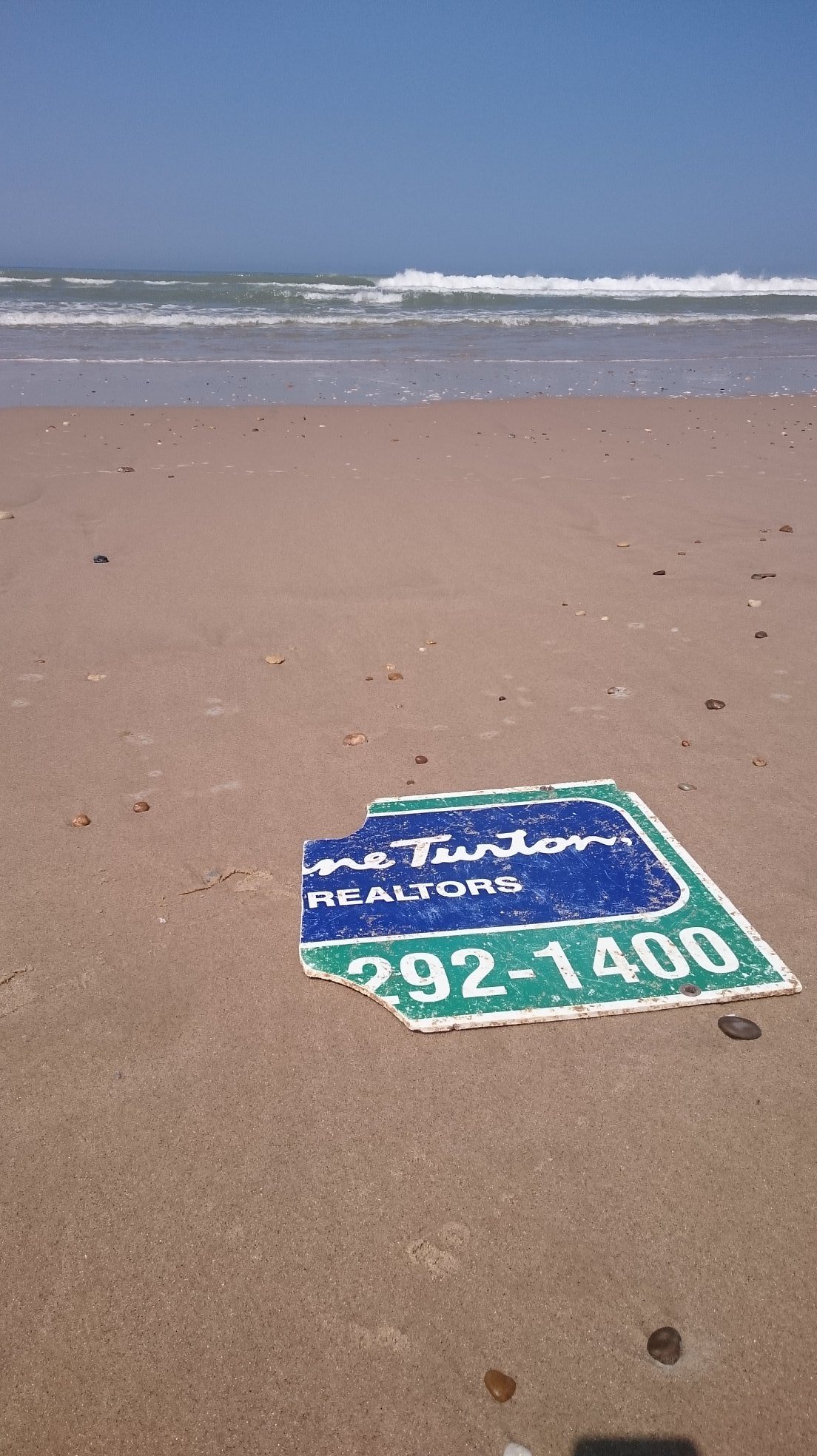A Sign From New Jersey Based Real Estate Company Washed Up On French Beach The Said It Lost During Hurricane Sandy