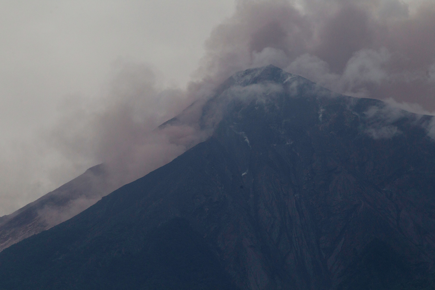 <div class='meta'><div class='origin-logo' data-origin='none'></div><span class='caption-text' data-credit='Luis Soto/AP Photo'>Volcan de Fuego, or Volcano of Fire, blows outs a thick cloud of ash, as seen from Alotenango, Guatemala, Sunday, June 3, 2018.</span></div>
