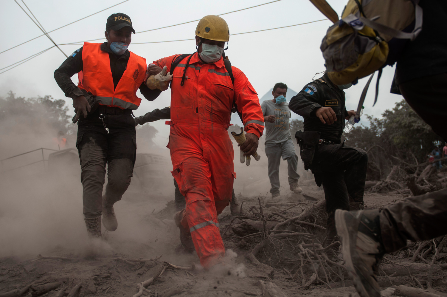 "<div class=""meta image-caption""><div class=""origin-logo origin-image none""><span>none</span></div><span class=""caption-text"">Firefighters and police are forced to evacuate a search and rescue effort as the Volcan de Fuego continues to spill out smoke and ash in Escuintla, Guatemala, Monday, June 4, 2018. (Oliver de Ros/AP Photo)</span></div>"
