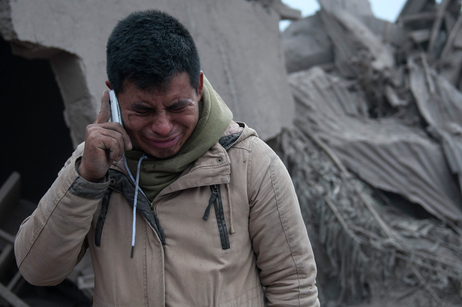 "<div class=""meta image-caption""><div class=""origin-logo origin-image none""><span>none</span></div><span class=""caption-text"">Boris Rodriguez, 24, who is searching for his wife, cries after seeing the condition of his neighborhood, destroyed by the erupting Volcan de Fuego in Guatemala, Monday, June 4. (Oliver de Ros/AP Photo)</span></div>"