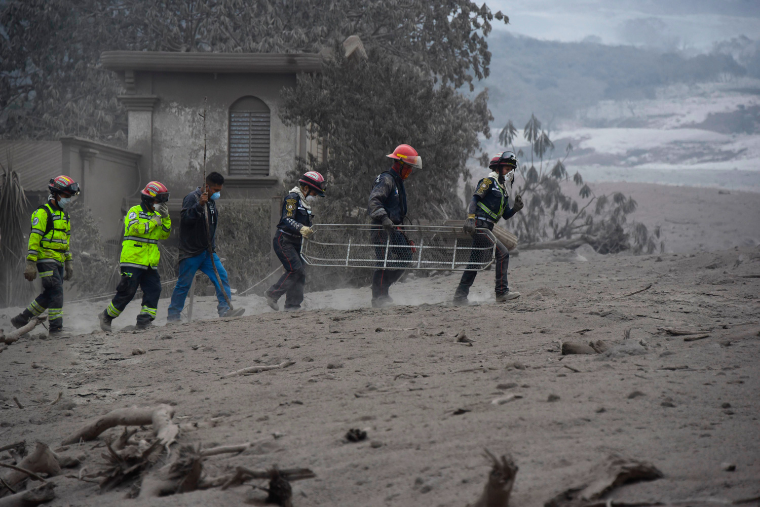 <div class='meta'><div class='origin-logo' data-origin='none'></div><span class='caption-text' data-credit='JOHAN ORDONEZ/AFP/Getty Images'>Rescuers search for victims in San Miguel Los Lotes, a village in Escuintla Department, about 35 km southwest of Guatemala City, on June 4, 2018, a day after the eruption.</span></div>