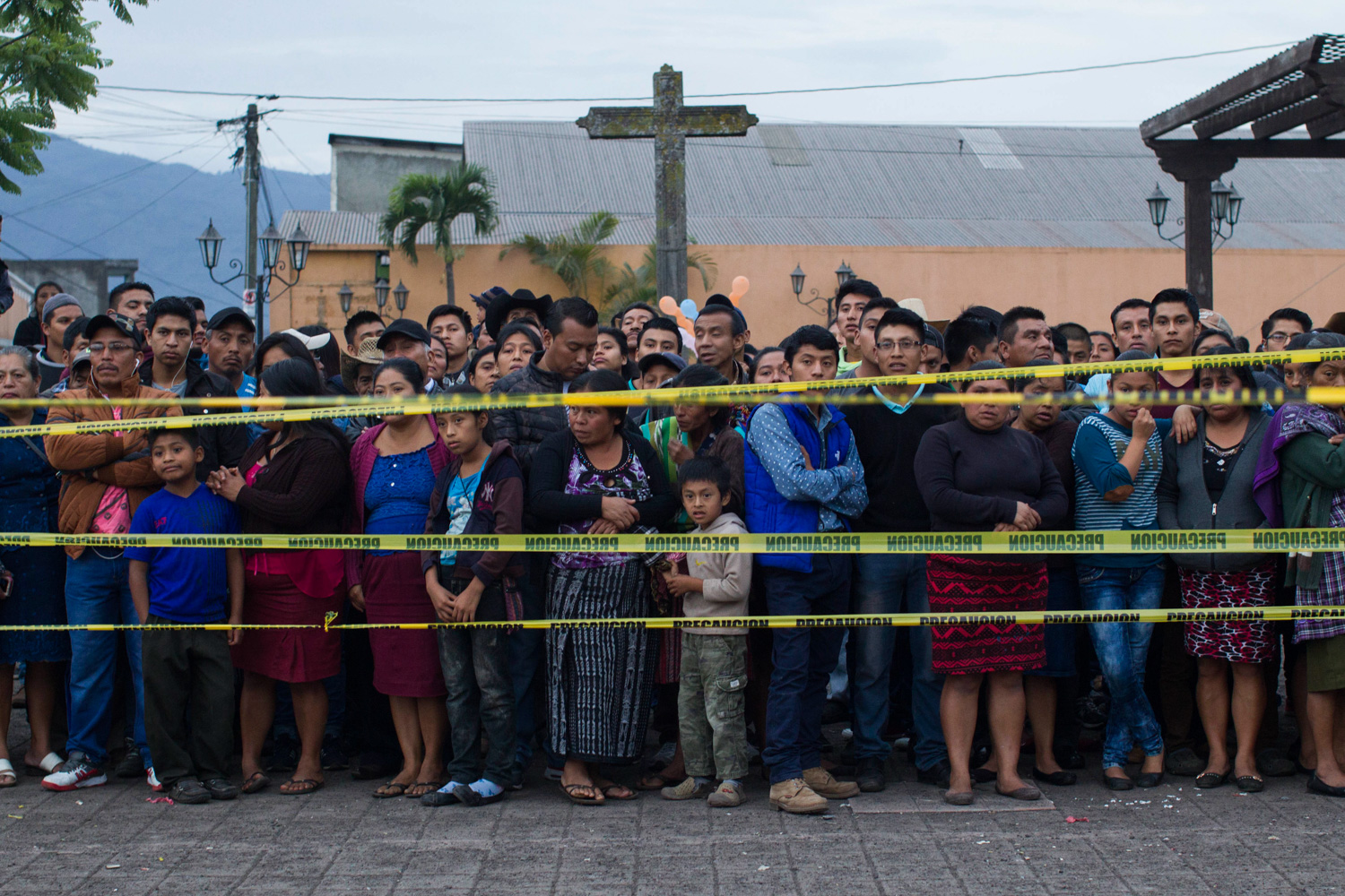 <div class='meta'><div class='origin-logo' data-origin='none'></div><span class='caption-text' data-credit='Luis Soto/AP Photo'>Neighbors stand outside a temporary morgue near Volcan de Fuego or Volcano of Fire in Alotenango, Guatemala, Sunday, June 3, 2018.</span></div>