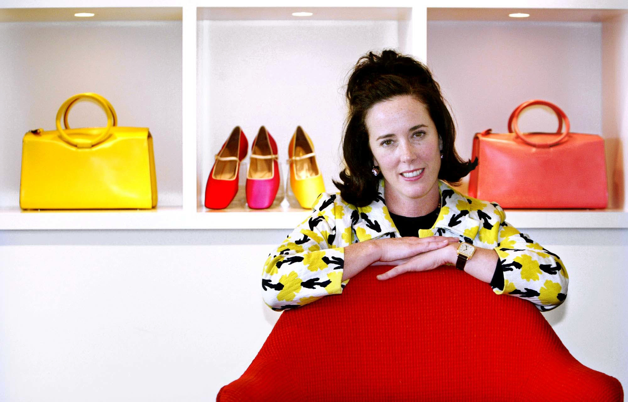 "<div class=""meta image-caption""><div class=""origin-logo origin-image none""><span>none</span></div><span class=""caption-text"">Kate Spade poses with handbags and shoes from her next collection in New York in 2004. (AP Photo/Bebeto Matthews, File)</span></div>"