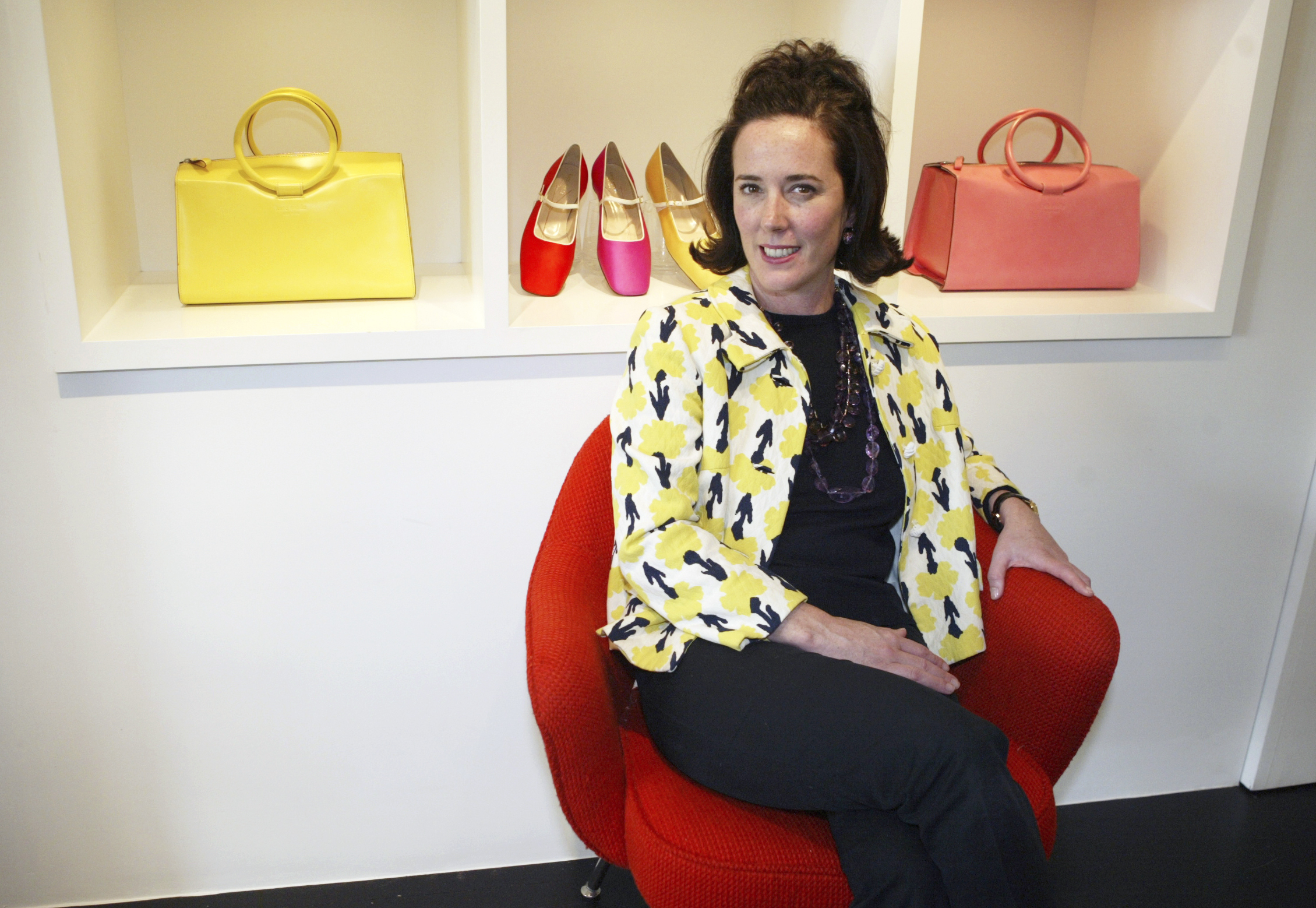 "<div class=""meta image-caption""><div class=""origin-logo origin-image ap""><span>AP</span></div><span class=""caption-text"">This May 13, 2004 photo shows designer Kate Spade posing among handbags and shoes from her collection in New York. (AP Photo/Bebeto Matthews, File) (AP)</span></div>"