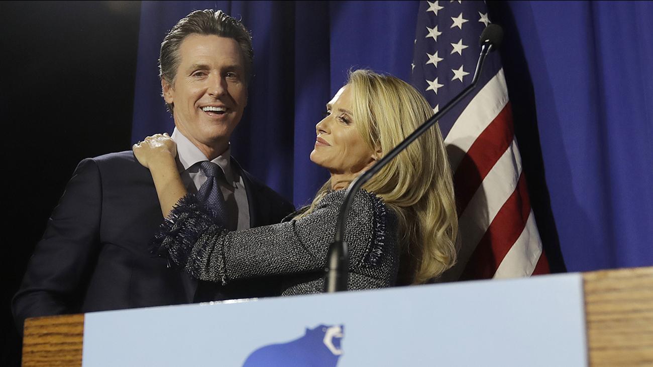 Democratic Lt. Gov. Gavin Newsom, left, hugs his wife Jennifer Siebel Newsom in San Francisco, Tuesday, June 5, 2018.