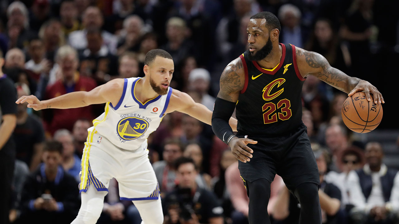 Cleveland Cavaliers' LeBron James is defended by Golden State Warriors' Stephen Curry during Game 3 of the NBA Finals in Cleveland.