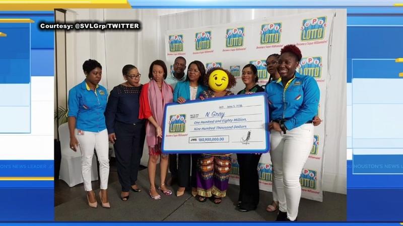 Lotto winner in Jamaica wears emoji mask to conceal identity