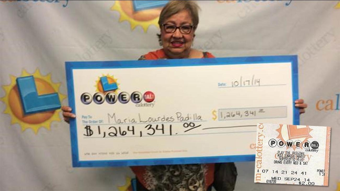 Maria Padilla of Fresno shows of a display check.