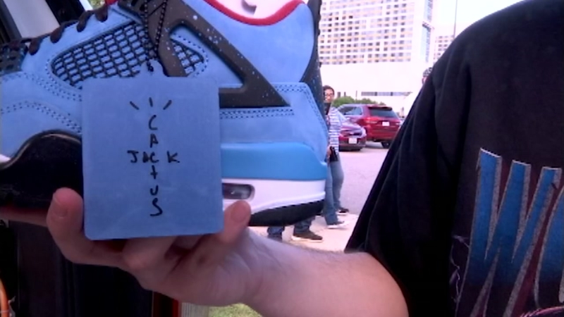 Travis Scott talks new baby and Houston-inspired shoes during block
