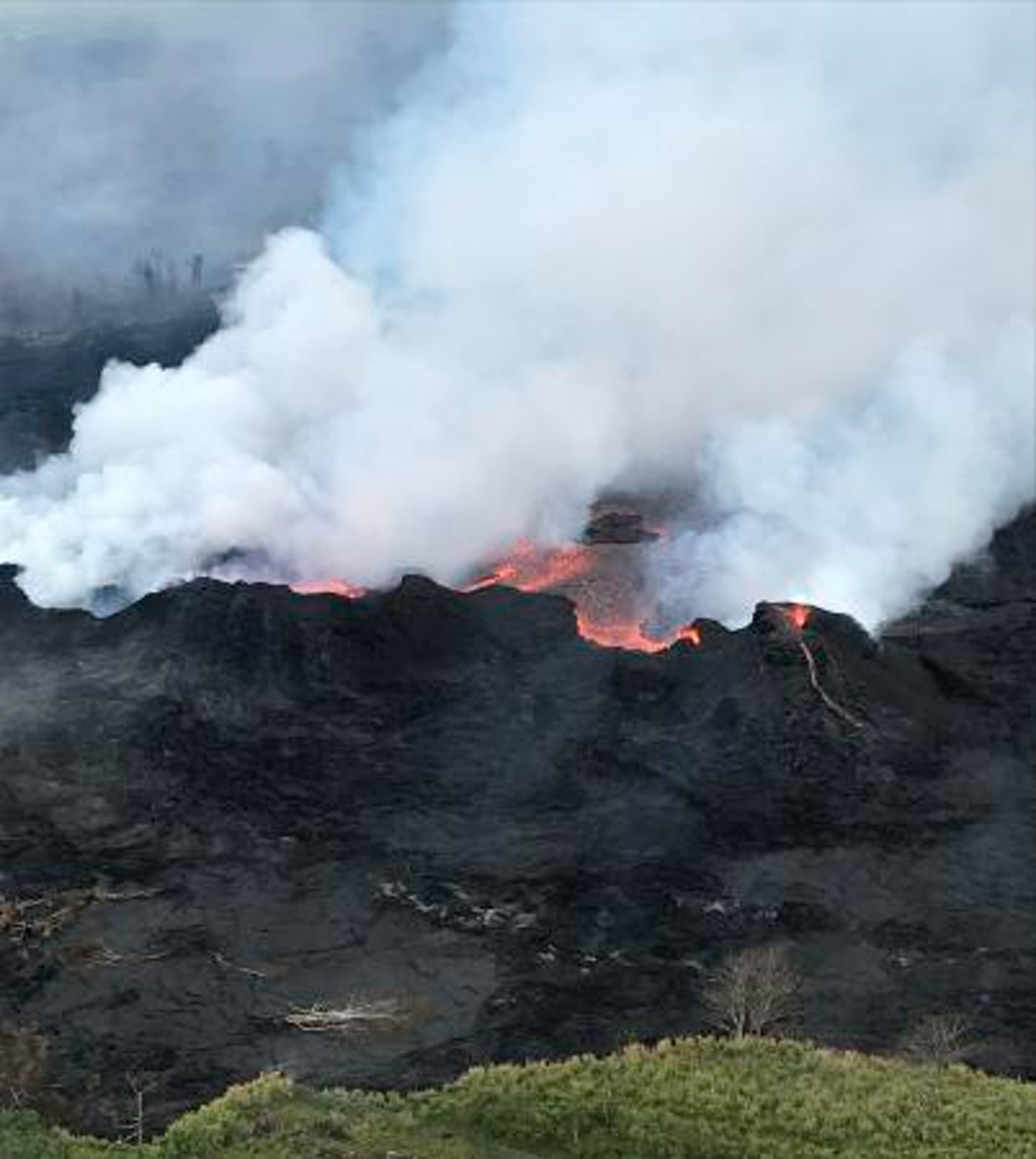 "<div class=""meta image-caption""><div class=""origin-logo origin-image none""><span>none</span></div><span class=""caption-text"">An aerial view of fissure 22 looking toward the south, as Kilauea Volcano continues its eruption cycle near Pahoa on the island of Kilauea, Hawaii. (U.S. Geological Survey via AP)</span></div>"