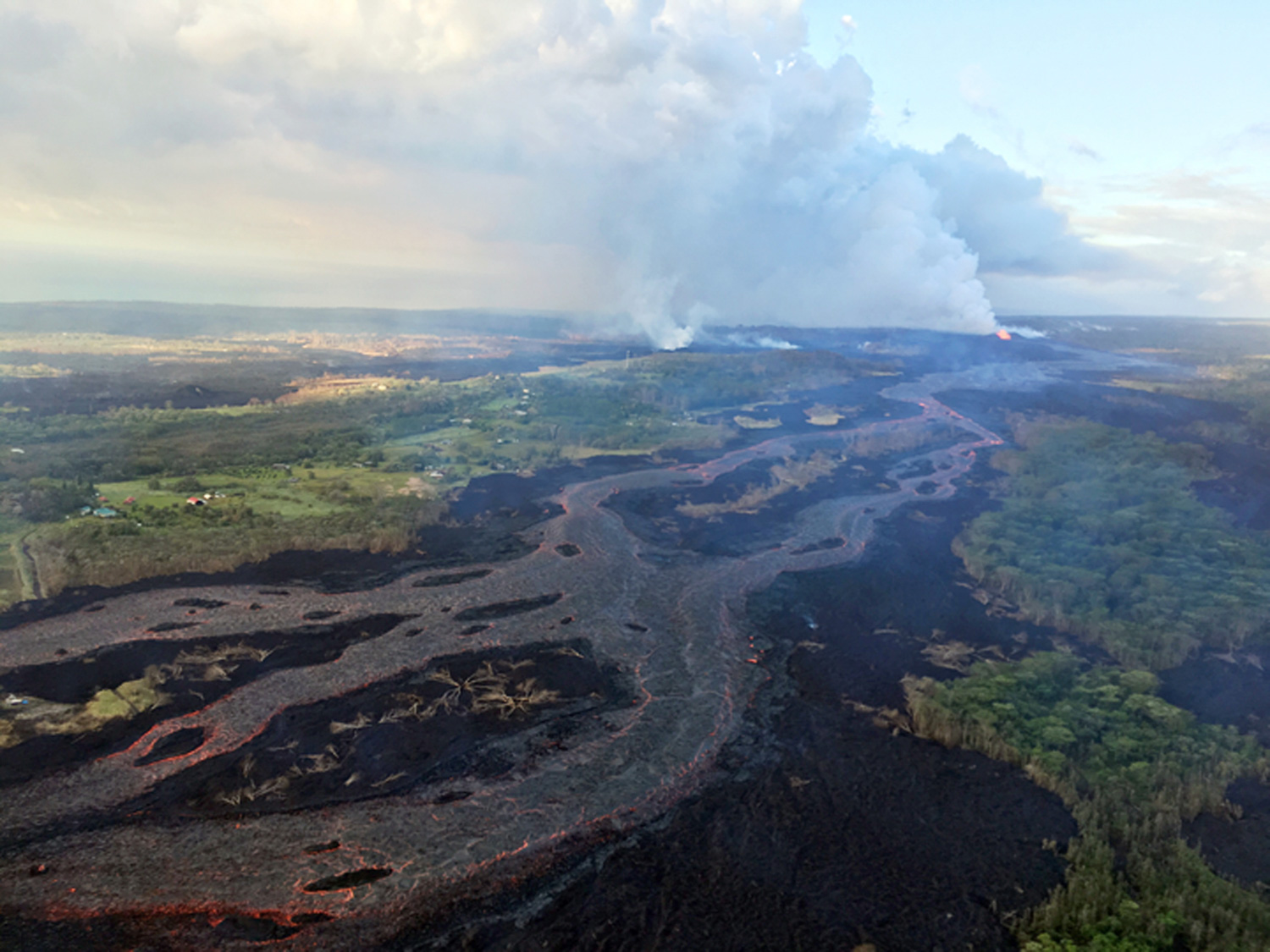 "<div class=""meta image-caption""><div class=""origin-logo origin-image none""><span>none</span></div><span class=""caption-text"">Kilauea's lower East Rift Zone, showing continued fountaining of a fissure and the lava flow channel fed by it near the town of Kapoho on the island of Hawaii. (U.S. Geological Survey via AP)</span></div>"