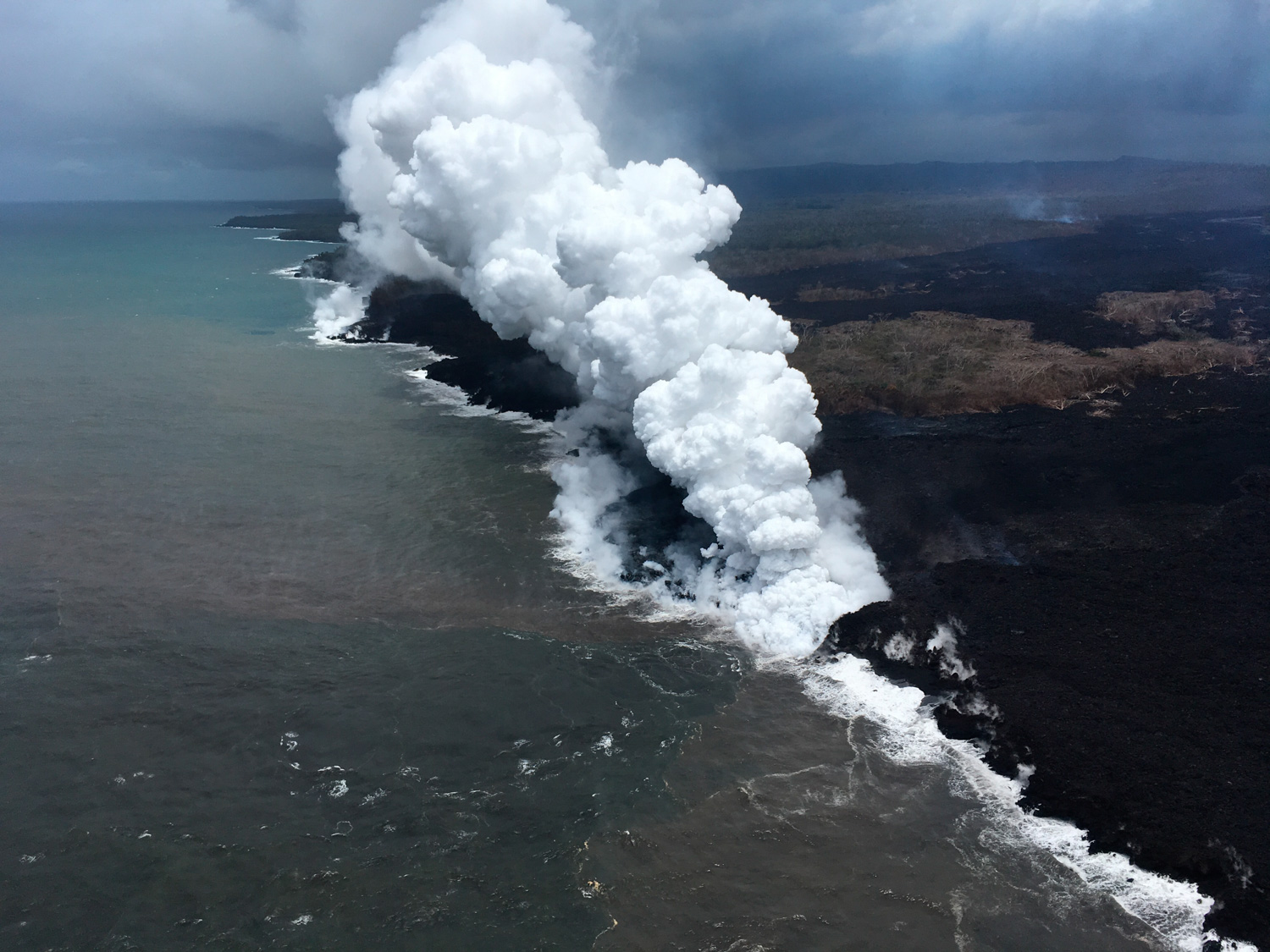 "<div class=""meta image-caption""><div class=""origin-logo origin-image none""><span>none</span></div><span class=""caption-text"">Lava sends up clouds of steam and toxic gases as it enters the Pacific Ocean as Kilauea Volcano continues its eruption cycle near Pahoa on the island of Kilauea, Hawaii. (U.S. Geological Survey via AP)</span></div>"
