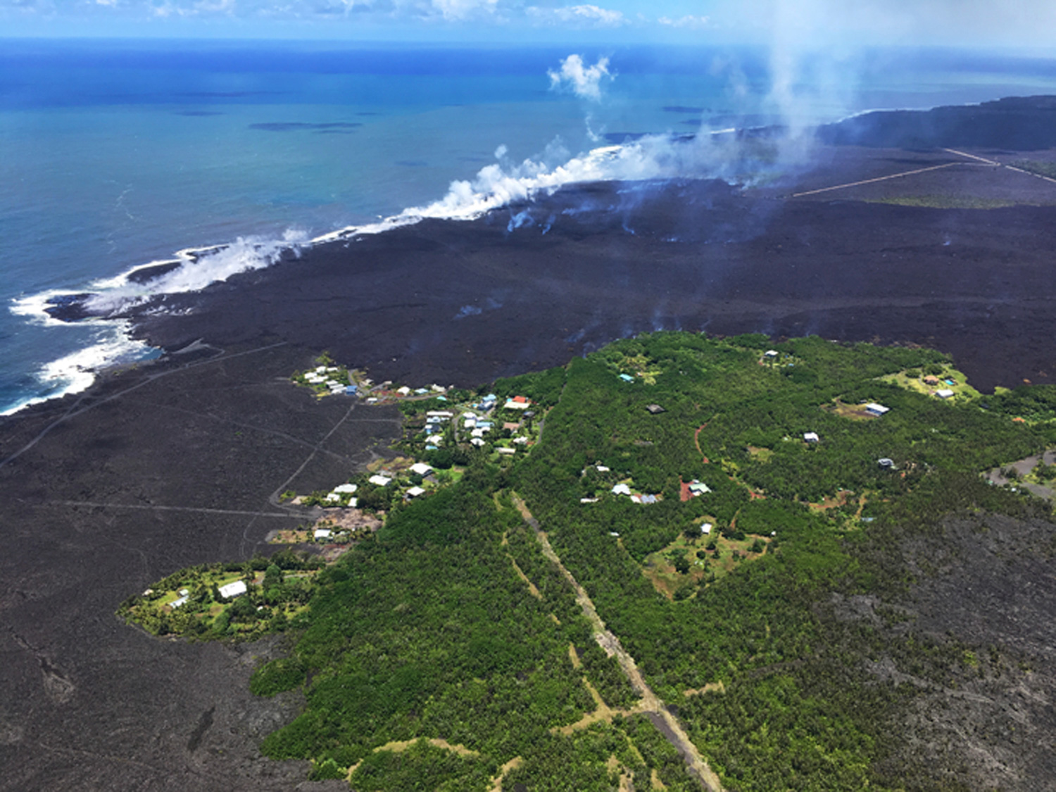 "<div class=""meta image-caption""><div class=""origin-logo origin-image none""><span>none</span></div><span class=""caption-text"">The remains of the Kapoho Beach Lots subdivision and a fissure flow front at the town of Kapoho on the island of Hawaii. (U.S. Geological Survey via AP)</span></div>"