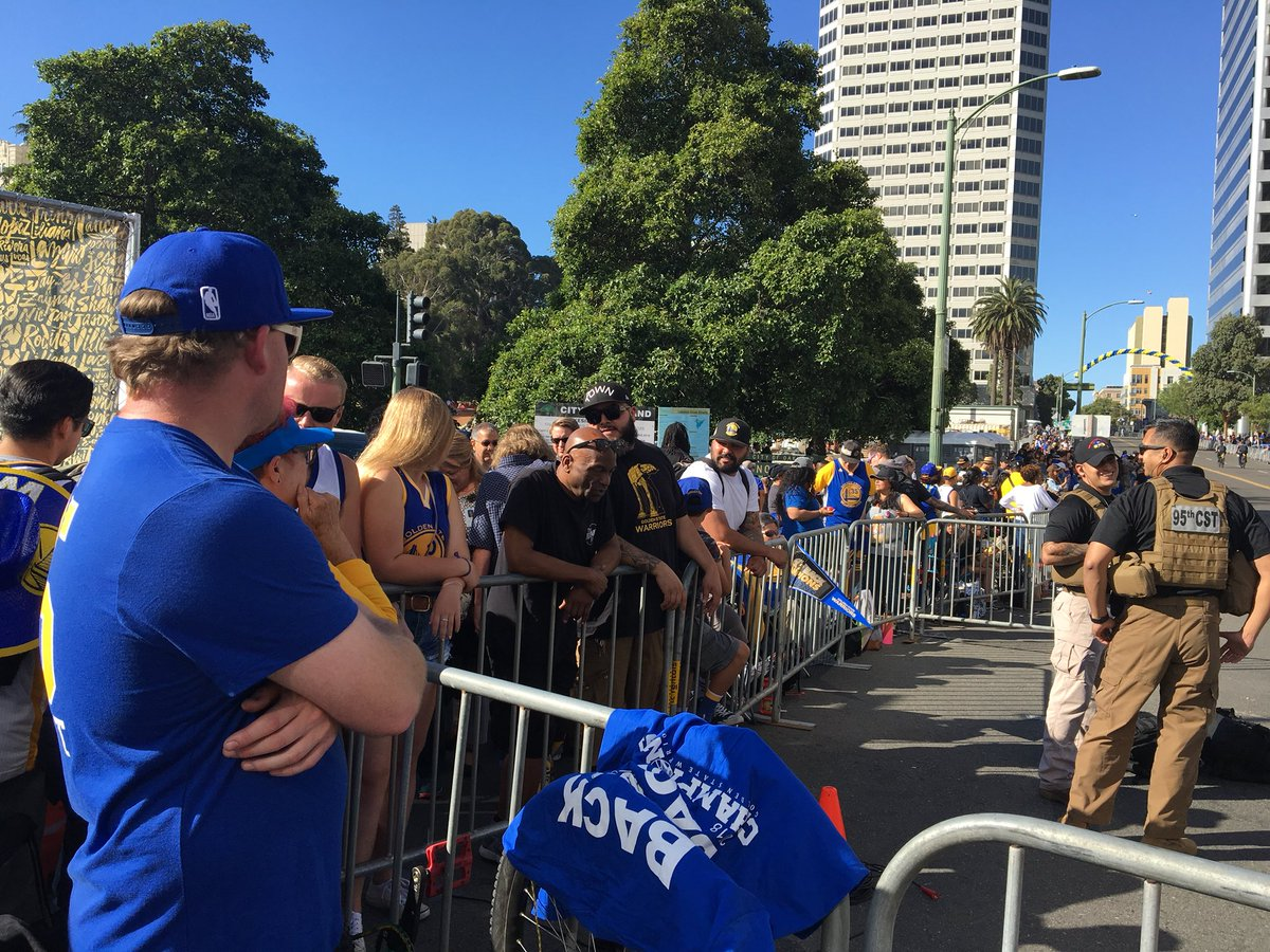 <div class='meta'><div class='origin-logo' data-origin='none'></div><span class='caption-text' data-credit='KGO-TV'>Members of Dub Nation wait for the Warriors parade to begin on Tuesday, June 12, 2018 in Oakland, Calif.</span></div>