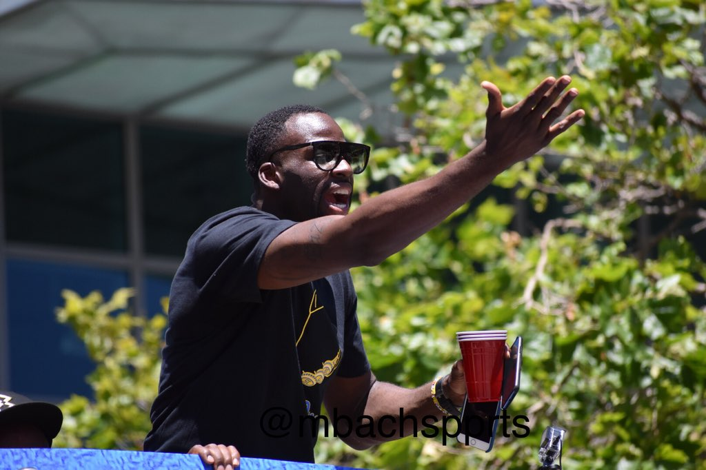 <div class='meta'><div class='origin-logo' data-origin='none'></div><span class='caption-text' data-credit='KGO-TV'>Draymond Green rides in a float during the Warriors parade on Tuesday, June 12, 2018 in Oakland, Calif.</span></div>