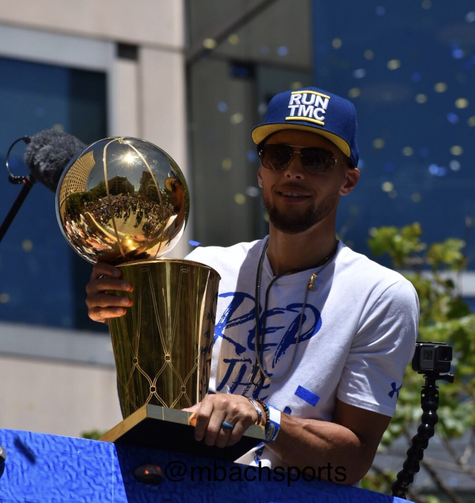 <div class='meta'><div class='origin-logo' data-origin='none'></div><span class='caption-text' data-credit='KGO-TV'>Stephen Curry holds the Larry O'Brien Trophy during the Warriors parade in Oakland, Calif. on Tuesday, June 12, 2018.</span></div>