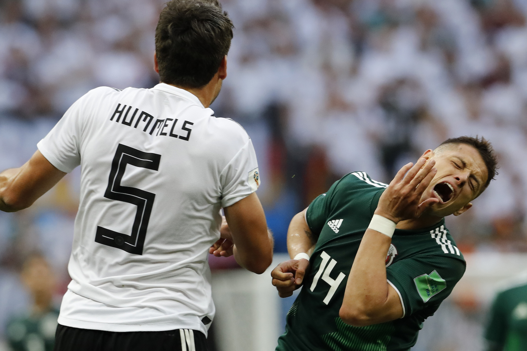 "<div class=""meta image-caption""><div class=""origin-logo origin-image ap""><span>AP</span></div><span class=""caption-text"">Mexico's Javier Hernandez, right, gestures as competes for the ball with Germany's Mats Hummels during the group F match between Germany and Mexico at the 2018 soccer World Cup. (AP Photo/Antonio Calanni)</span></div>"