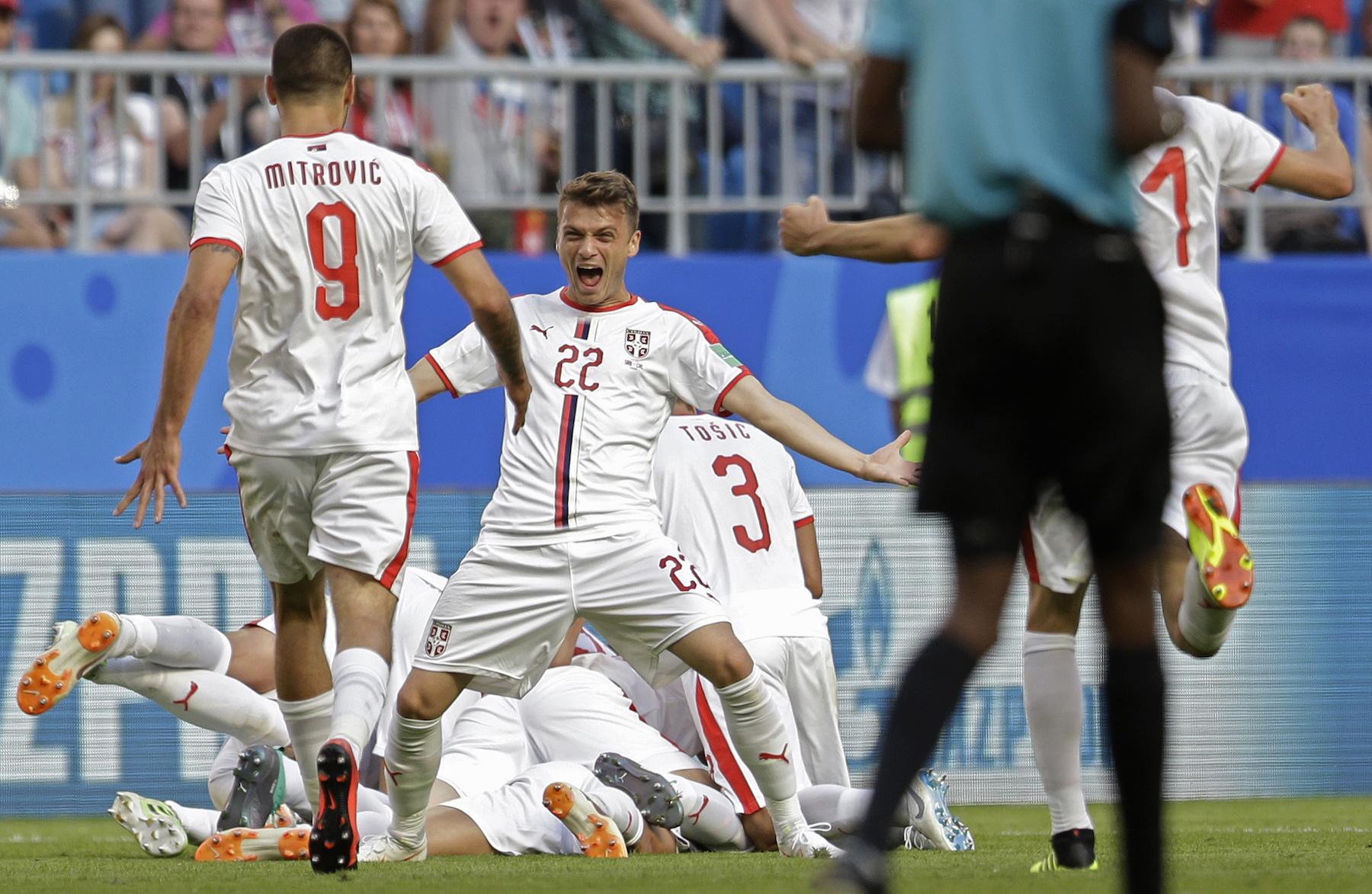 <div class='meta'><div class='origin-logo' data-origin='AP'></div><span class='caption-text' data-credit='AP Photo/Natacha Pisarenko'>Serbia's Adem Ljajic, centre, celebrates after teammate Aleksandar Kolarov scored the opening goal during the group E match between Costa Rica and Serbia.</span></div>