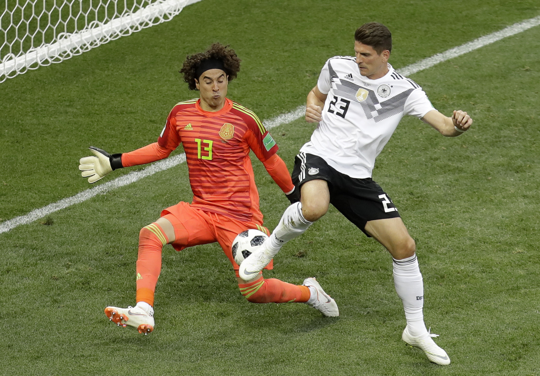 <div class='meta'><div class='origin-logo' data-origin='AP'></div><span class='caption-text' data-credit='AP Photo/Michael Probst'>Mexico goalkeeper Guillermo Ochoa blocks Germany's Mario Gomez during the group F match between Germany and Mexico at the 2018 soccer World Cup.</span></div>