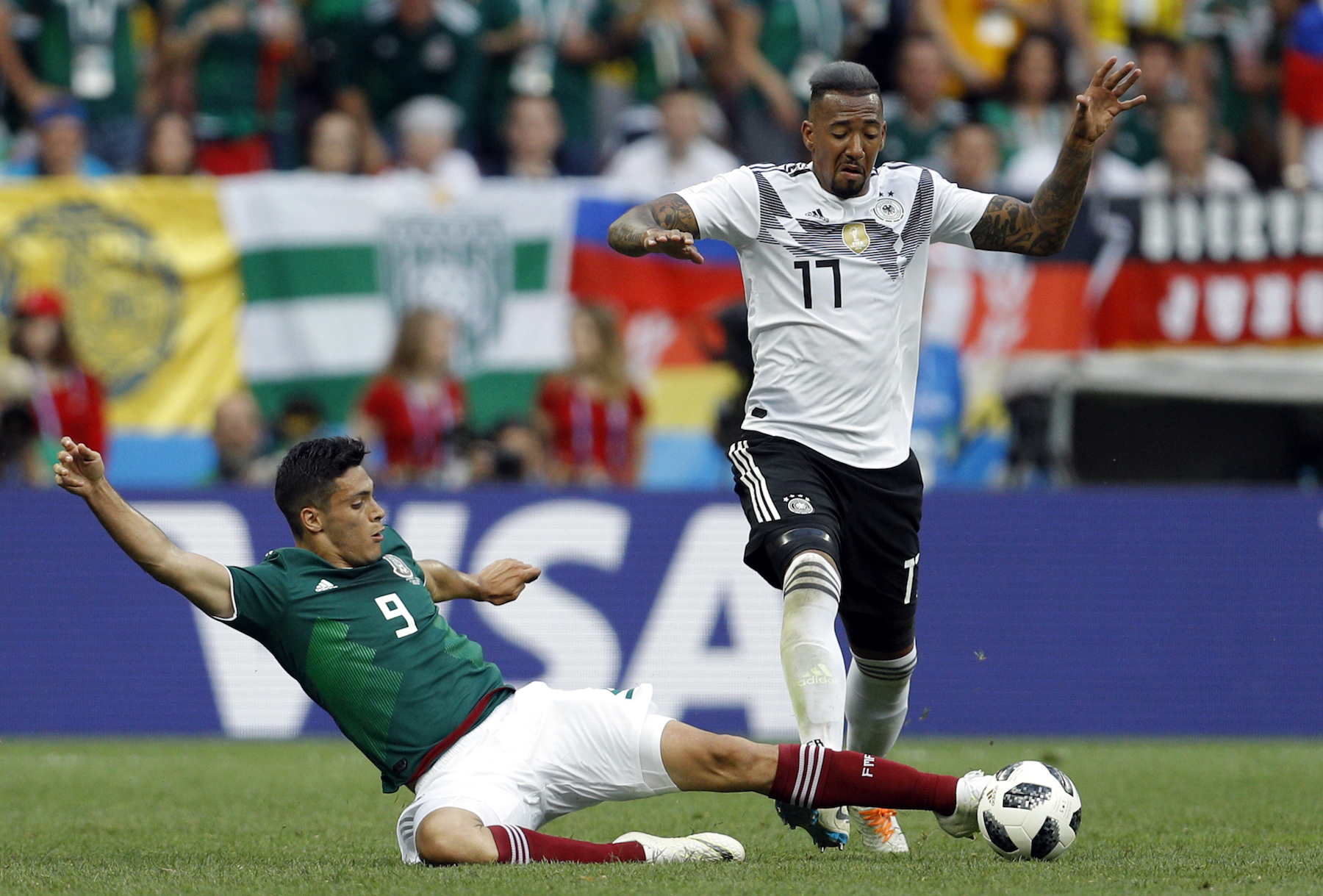 <div class='meta'><div class='origin-logo' data-origin='AP'></div><span class='caption-text' data-credit='AP Photo/Victor R. Caivano'>Mexico's Raul Jimenez, left, tackles Germany's Jerome Boateng during the group F match between Germany and Mexico at the 2018 soccer World Cup in the Luzhniki Stadium.</span></div>