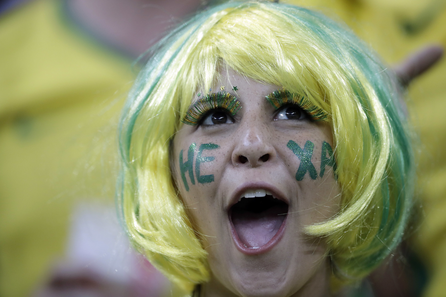 "<div class=""meta image-caption""><div class=""origin-logo origin-image ap""><span>AP</span></div><span class=""caption-text"">A soccer fan cheers ahead of the group E match between Brazil and Switzerland at the 2018 soccer World Cup in the Rostov Arena in Rostov-on-Don, Russia, Sunday, June 17, 2018. (AP Photo/Felipe Dana)</span></div>"