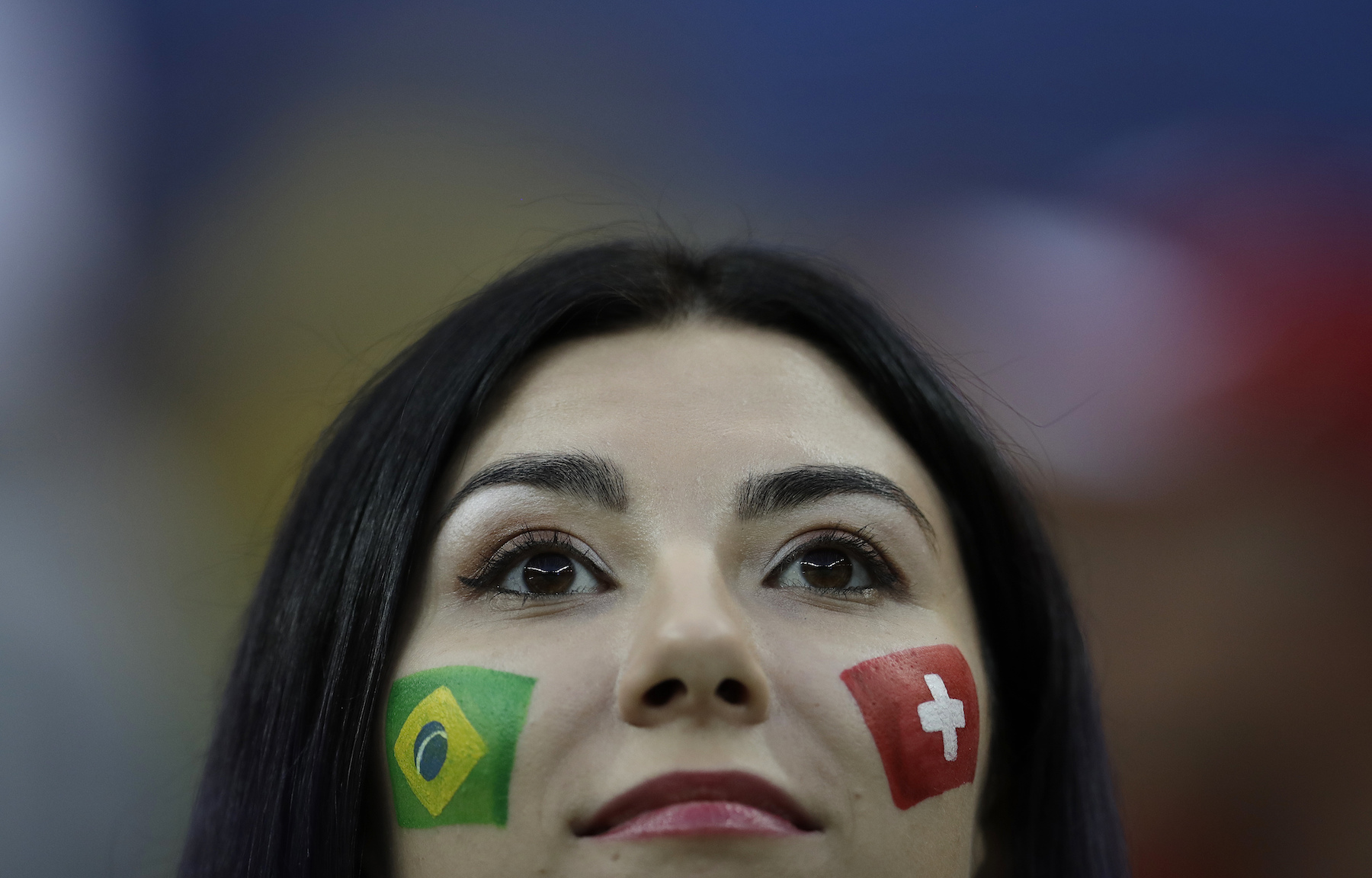 "<div class=""meta image-caption""><div class=""origin-logo origin-image ap""><span>AP</span></div><span class=""caption-text"">A soccer supporter show flags painted on her cheeks during the group E match between Brazil and Switzerland at the 2018 soccer World Cup in the Rostov Arena. (AP Photo/Felipe Dana)</span></div>"