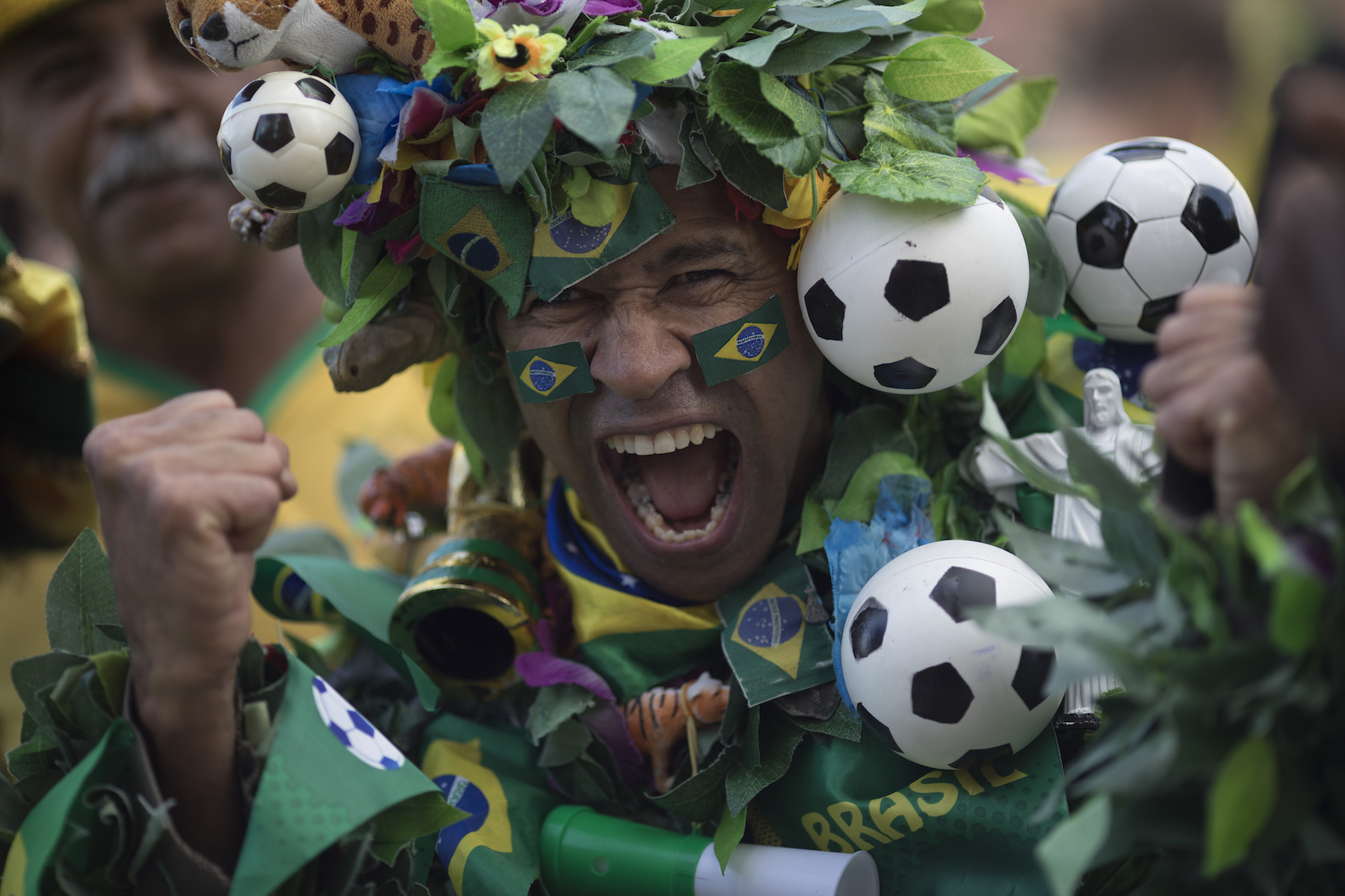 "<div class=""meta image-caption""><div class=""origin-logo origin-image ap""><span>AP</span></div><span class=""caption-text"">A Brazil soccer fan, in a costume, poses to the camera as he cheers before his team's World Cup match against Switzerland in Rio de Janeiro, Brazil, Sunday, June 17, 2018. (AP Photo/Leo Correa)</span></div>"