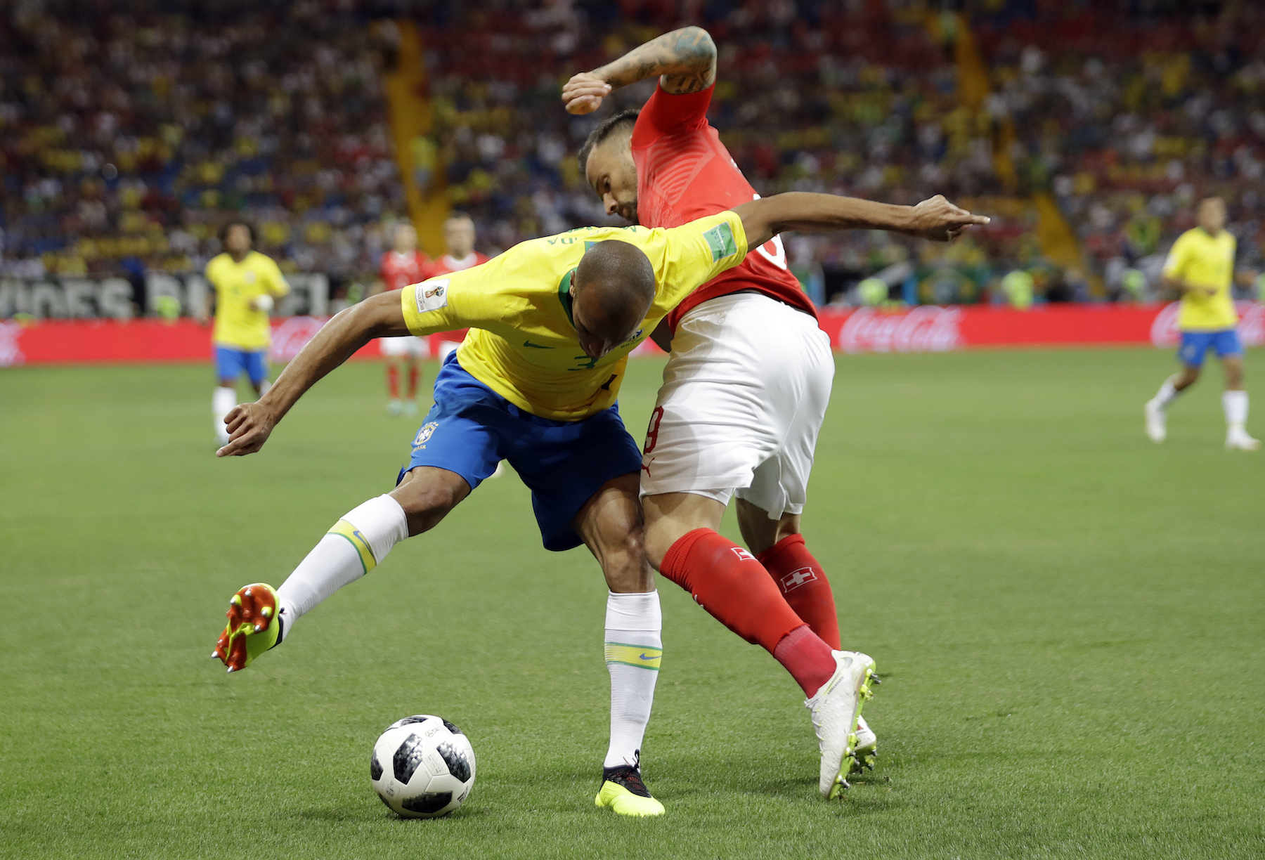 <div class='meta'><div class='origin-logo' data-origin='AP'></div><span class='caption-text' data-credit='AP Photo/Felipe Dana'>Brazil's Miranda, left, and Switzerland's Haris Seferovic challenge for the ball during the group E match between Brazil and Switzerland.</span></div>