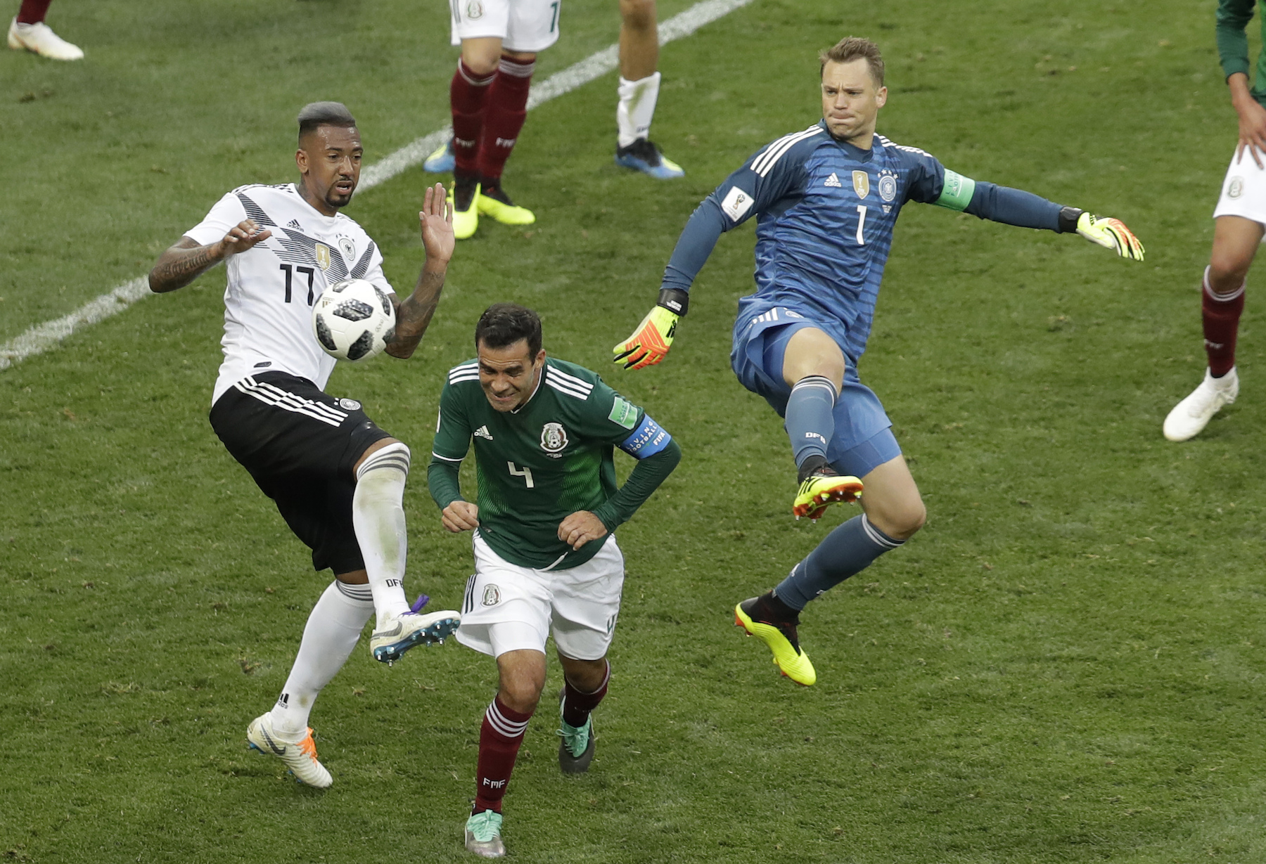 <div class='meta'><div class='origin-logo' data-origin='AP'></div><span class='caption-text' data-credit='AP Photo/Michael Probst'>Germany's Jerome Boateng, left, and goalkeeper Manuel Neuer challenge for the ball with Mexico's Rafael Marquez during the group F match between Germany and Mexico.</span></div>