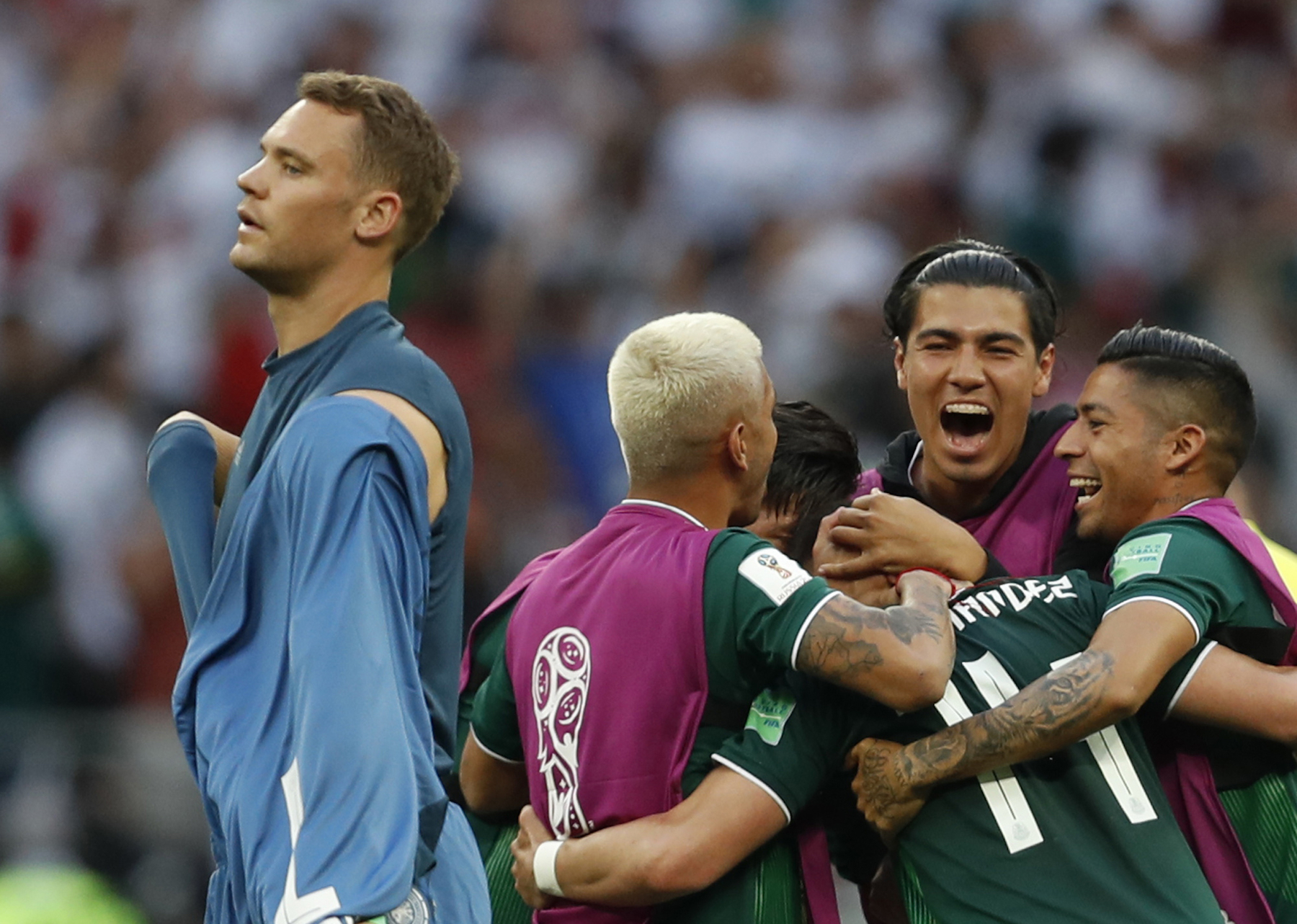 <div class='meta'><div class='origin-logo' data-origin='AP'></div><span class='caption-text' data-credit='AP Photo/Eduardo Verdugo'>Germany goalkeeper Manuel Neuer walks past as Mexico players celebrate after defeating Germany 1-0 in their group F match at the 2018 soccer World Cup.</span></div>