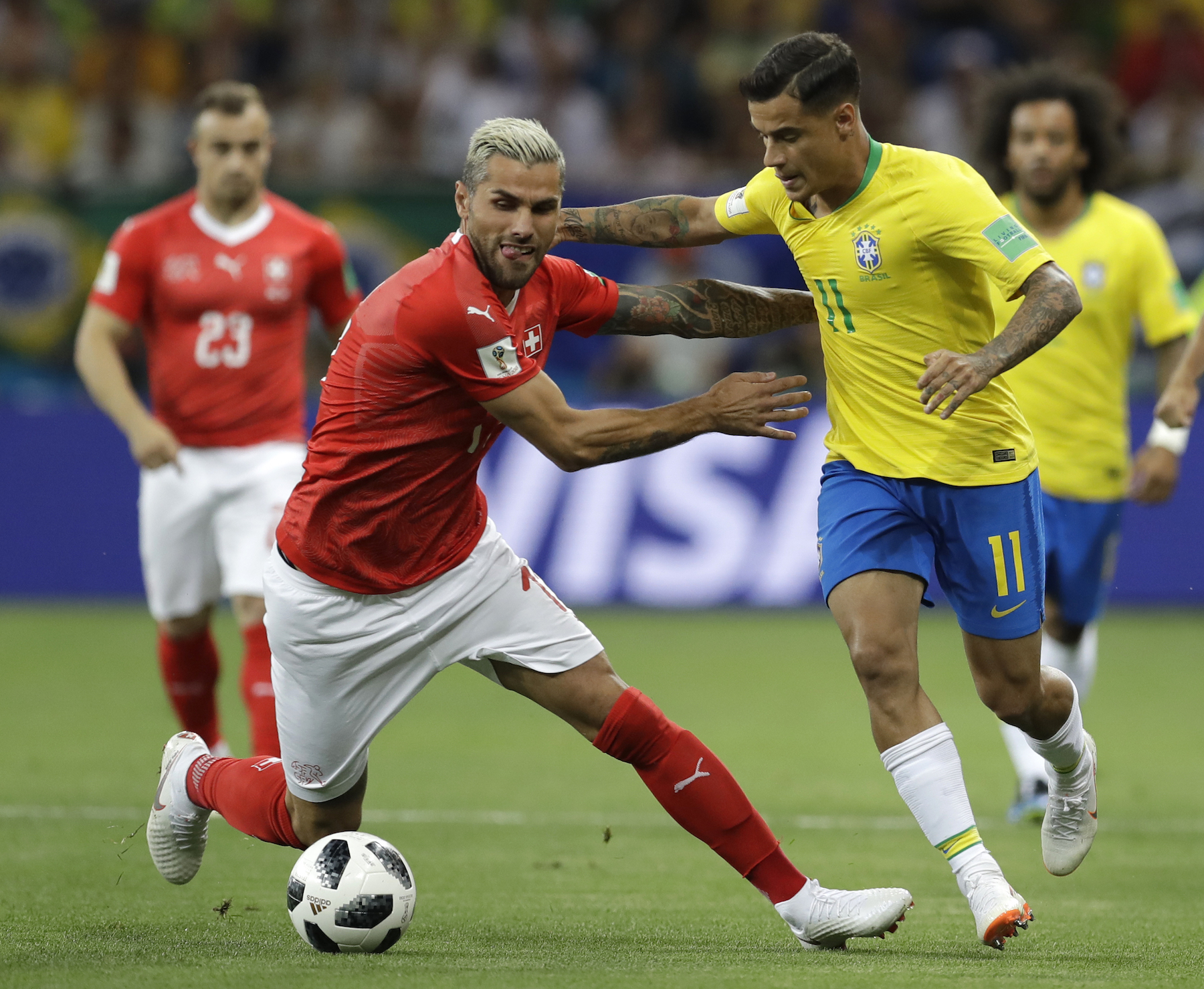 <div class='meta'><div class='origin-logo' data-origin='AP'></div><span class='caption-text' data-credit='AP Photo/Themba Hadebe'>Switzerland's Valon Behrami, left, and Brazil's Philippe Coutinho challenge for the ball during the group E match between Brazil and Switzerland at the 2018 soccer World Cup.</span></div>