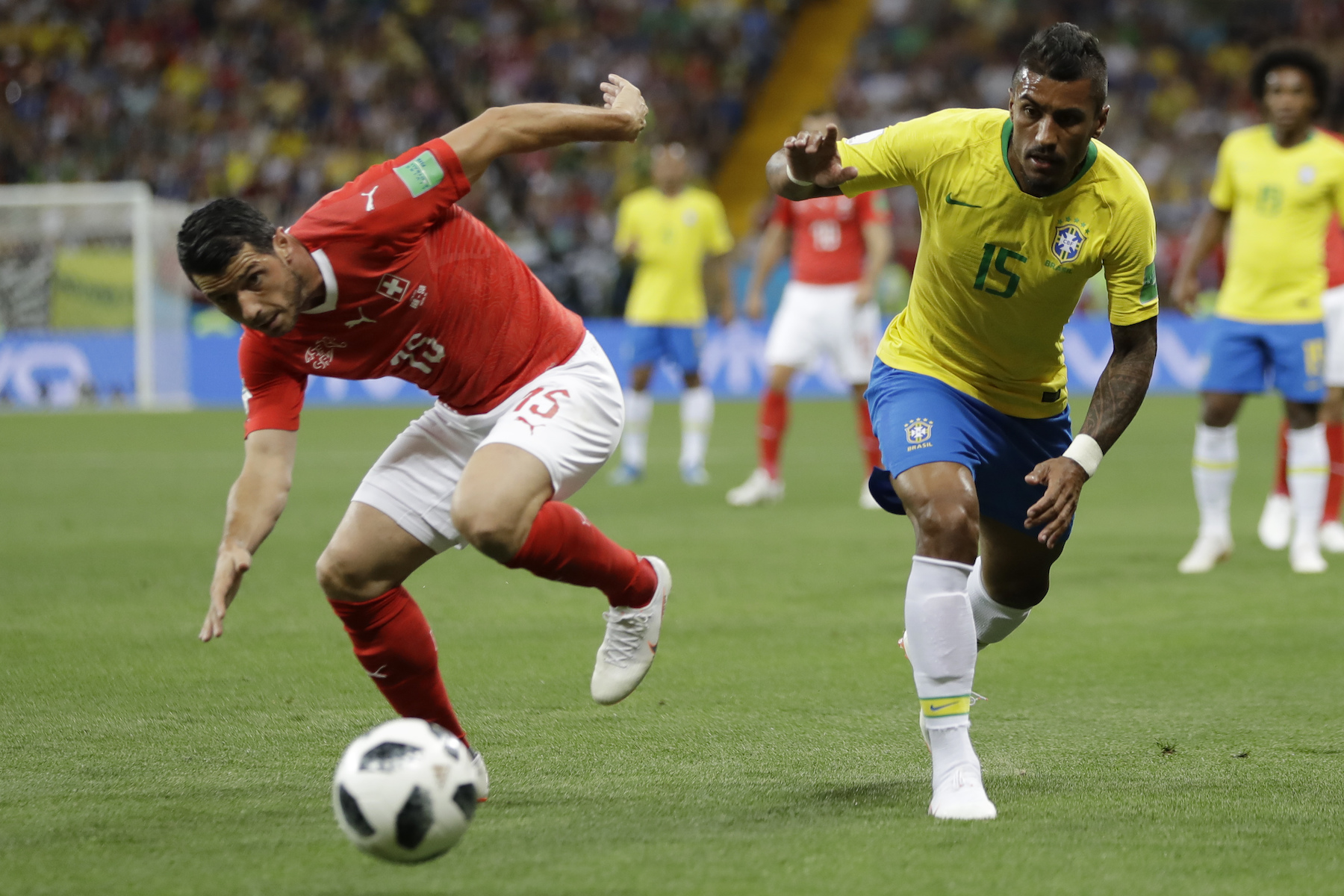 "<div class=""meta image-caption""><div class=""origin-logo origin-image ap""><span>AP</span></div><span class=""caption-text"">Switzerland's Blerim Dzemaili, left, and Brazil's Paulinho eye the during their group E match at the 2018 soccer World Cup in the Rostov Arena in Rostov-on-Don, Russia. (AP Photo/Andre Penner)</span></div>"
