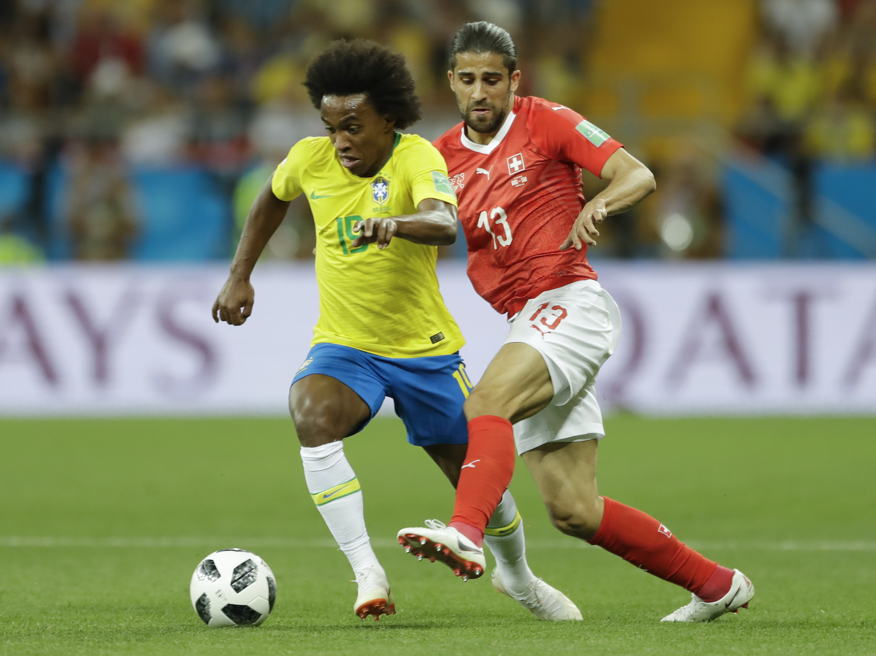 <div class='meta'><div class='origin-logo' data-origin='AP'></div><span class='caption-text' data-credit='AP Photo/Andre Penner'>Brazil's Paulinho, left, is challenged by Switzerland's Ricardo Rodriguez during their group E match at the 2018 soccer World Cup in the Rostov Arena in Rostov-on-Don, Russia.</span></div>