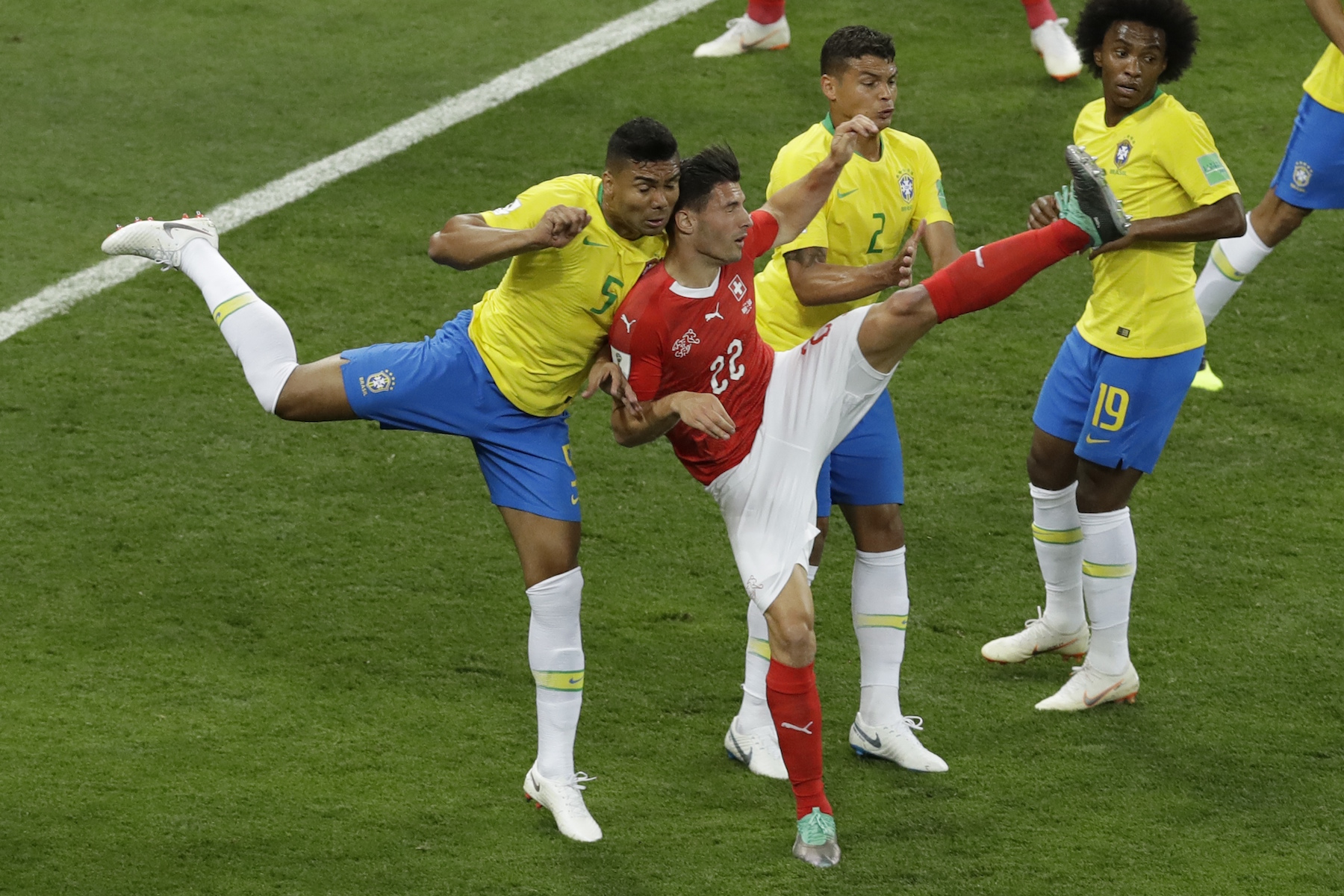 "<div class=""meta image-caption""><div class=""origin-logo origin-image ap""><span>AP</span></div><span class=""caption-text"">Brazil's Casemiro, left, and Switzerland's Fabian Schaer collide during the group E match between Brazil and Switzerland at the 2018 soccer World Cup. (AP Photo/Andrew Medichini)</span></div>"