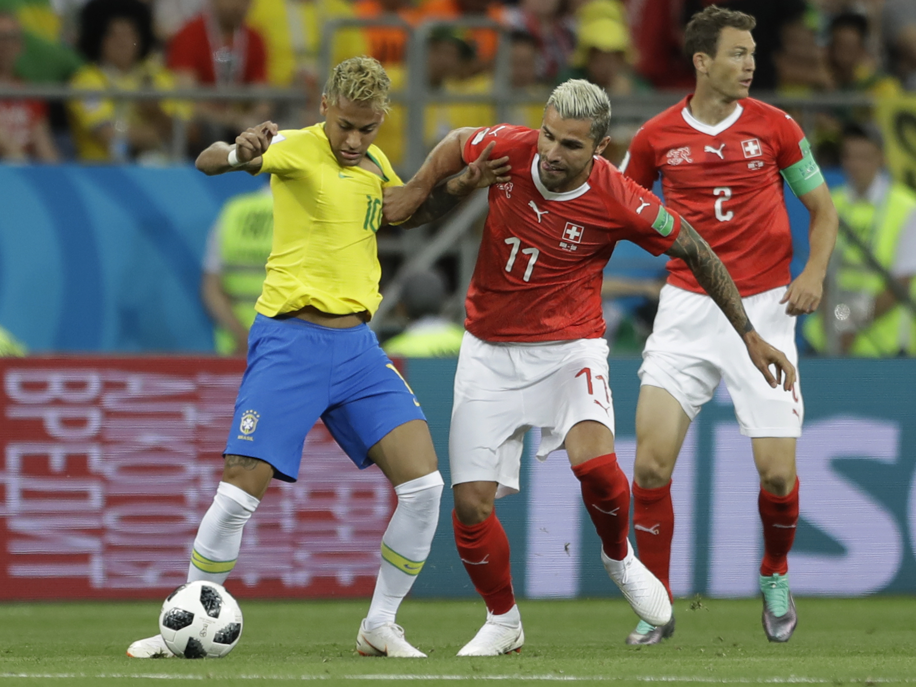 "<div class=""meta image-caption""><div class=""origin-logo origin-image ap""><span>AP</span></div><span class=""caption-text"">Brazil's Neymar, left, is challenged for the ball by Switzerland's Valon Behrami during the group E match between Brazil and Switzerland at the 2018 soccer World Cup. (AP Photo/Andre Penner)</span></div>"