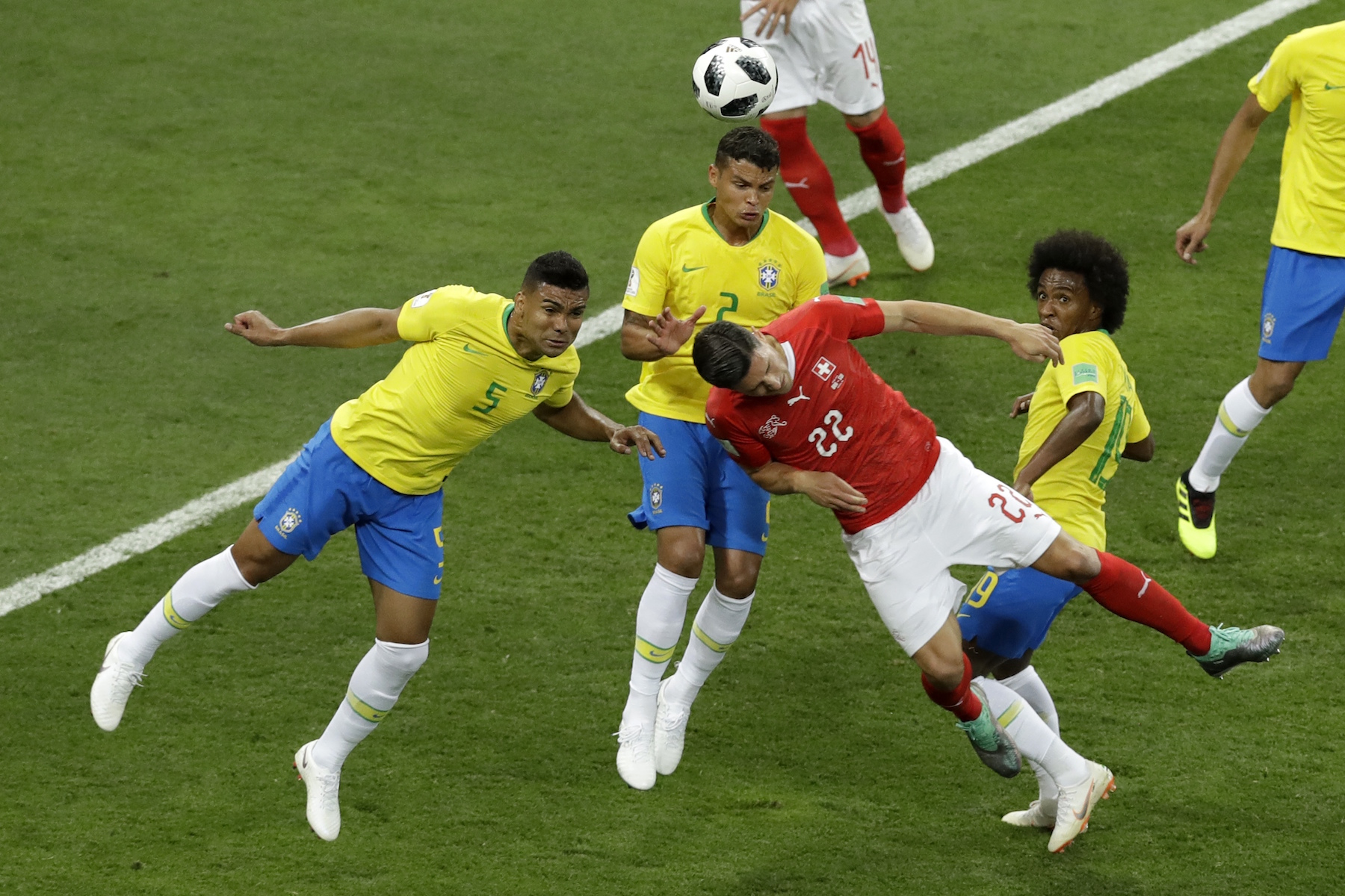 <div class='meta'><div class='origin-logo' data-origin='AP'></div><span class='caption-text' data-credit='AP Photo/Andrew Medichini'>Brazil's Casemiro, left, Thiago Silvaand, center, and Switzerland's Fabian Schaer jump for the ball during the group E match between Brazil and Switzerland.</span></div>