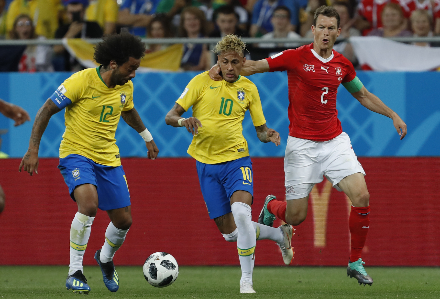 "<div class=""meta image-caption""><div class=""origin-logo origin-image ap""><span>AP</span></div><span class=""caption-text"">Brazil's Neymar, center, duels for the ball with Switzerland's Stephan Lichtsteiner, right, during the group E match between Brazil and Switzerland at the 2018 soccer World Cup. (AP Photo/Darko Vojinovic)</span></div>"