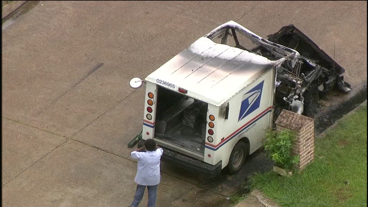 postal truck erupts in flames after mail carrier smells gas while driving in nw harris co abc13com