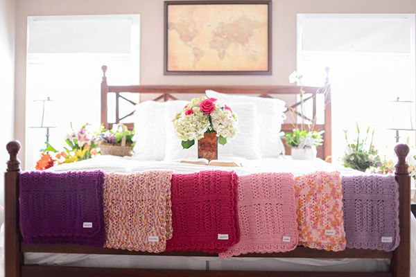 """<div class=""""meta image-caption""""><div class=""""origin-logo origin-image """"><span></span></div><span class=""""caption-text"""">Blankets knit for each of the six girls by a member of the Justice's church. (Justice Family)</span></div>"""