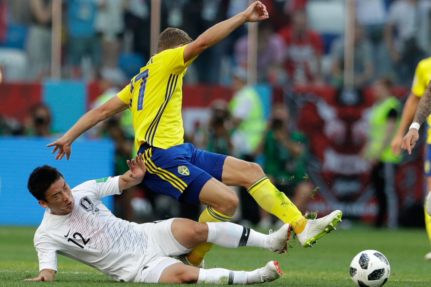 <div class='meta'><div class='origin-logo' data-origin='none'></div><span class='caption-text' data-credit='Petr David Josek/AP'>Sweden's Viktor Claesson is tackled by South Korea's Kim Min-woo during the group F match between Sweden and South Korea</span></div>