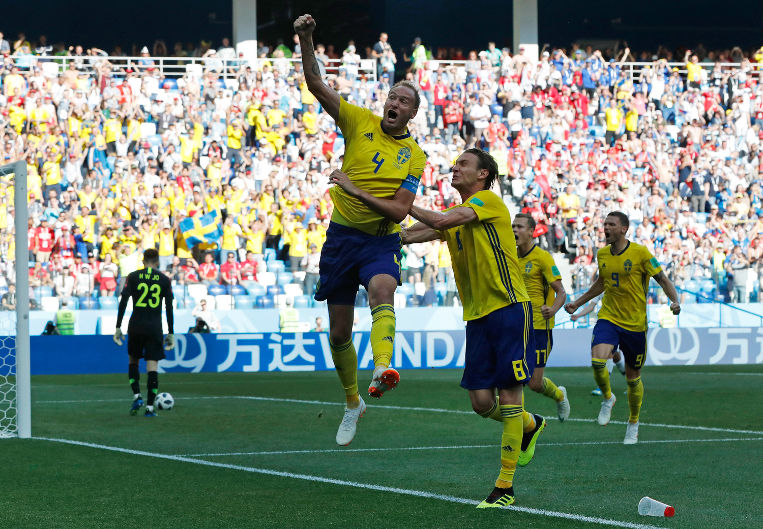 "<div class=""meta image-caption""><div class=""origin-logo origin-image none""><span>none</span></div><span class=""caption-text"">Sweden's Andreas Granqvist, centre, celebrates after scoring the opening goal during the group F match between Sweden and South Korea at the 2018 soccer World Cup (Pavel Golovkin/AP)</span></div>"