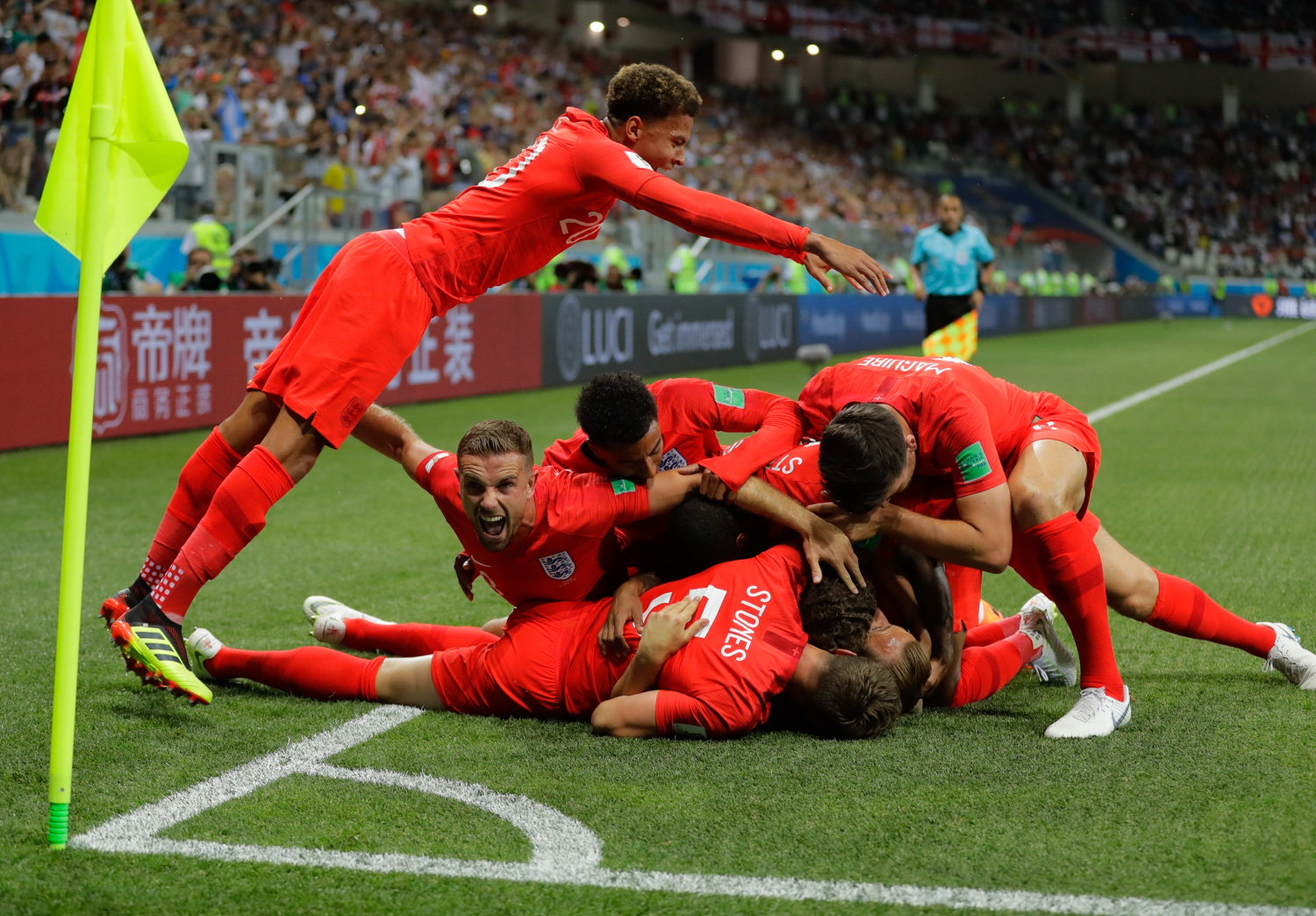 "<div class=""meta image-caption""><div class=""origin-logo origin-image none""><span>none</span></div><span class=""caption-text"">England's team celebrate after scoring their side's opening goal against Tunisia during the group G match between Tunisia and England (/Sergei Grits/AP Photo)</span></div>"