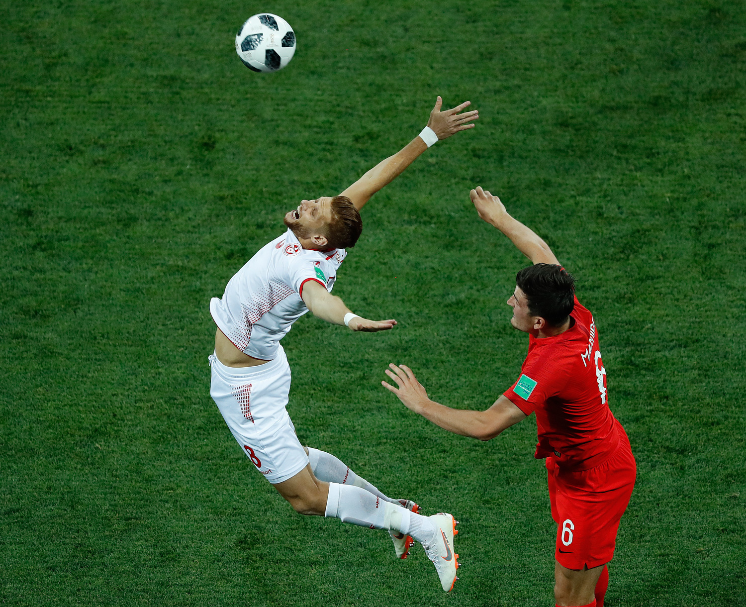 <div class='meta'><div class='origin-logo' data-origin='none'></div><span class='caption-text' data-credit='Rebecca Blackwell/AP Photo'>Tunisia's Rami Bedoui, rich. and England's Jordan Henderson challenge for the ball during the group G match between Tunisia and England</span></div>